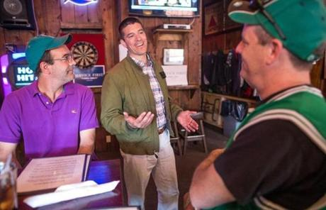 "Gabriel E. Gomez greeted supporters at the Uptowne Pub in Franklin. He is a Cohasset private equity investor and first-time statewide candidate on his ""Service First"" tour."