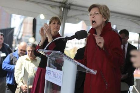 US Senator Elizabeth Warren, with Massachusetts Attorney General Martha Coakley, speaks at a rally of New England fishermen in Boston.