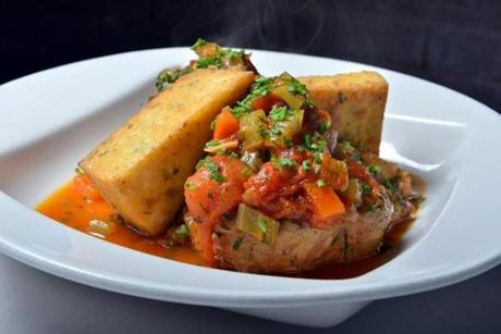 osso buco is braised pork shank in tomato sauce with crispy polenta.
