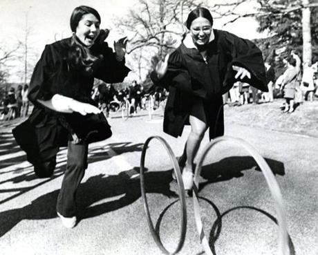 April 27, 1974: Wellesley College seniors raced hoop and hoop down the lane.  After the race, the seniors give their hoops to the sophomores. Some hoops are passed on for many years and bear the signatures of previous owners