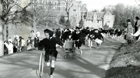 May 2, 1959: One contestant, a married member of the class, pushed a baby carriage through the race in place of the traditional hoop. But the hoopsters took first place and the race was won by Amalya Kearse from Vauxhall, NJ. Amalya told reporters she had no plans for marriage and was going onto law school at the University of Michigan.