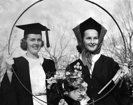 May 1, 1940: Margie Hudson (left), President of the senior class at Wellesley College, presented the winner of the hoop rolling contest, Martha Attridge of Morristown, N.J., her