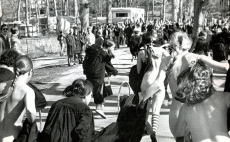 April 27 1974 / fromthearchive / AP photo / Four streakers, clad only in socks and sneakers and carrying their caps and gowns, raced across the finish line in the annual hoop race. The contest was not won by one of the streakers! Margaret Lahey, of West Hartford, CT won the race but said she was not anxious to be a bride right away. She planned a career in law or drama.
