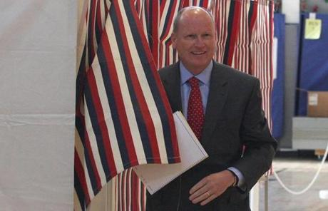State Representative Daniel Winslow cast his ballot at the Freeman-Kennedy School  in Norfolk.