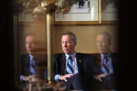 BOSTON , MA. 05/ 01/13: NEEDED TO BE IN 3 PLACES AT ONCE.....Congressman Stephen Lynch seated in a private before a breakfast unity meeting to show a unified Democratic Party at the Parker House is in triplicate reflected in a glass doorway . ( David L Ryan/Globe Staff Photo ) SECTION: METRO TOPIC 02senate