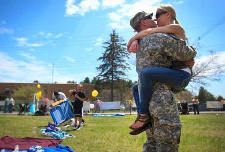 5/02/2013 - Reading, MA - Beth VanEmburgh, cq, of Action, embraces her boyfriend, Staff Sgt. Paul Beach, cq. upon his return.