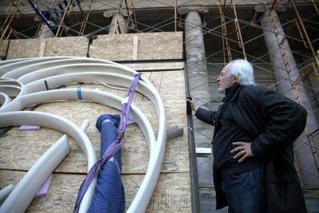 Artist Donald Lipski checked out his work before it is hung in the pediment above the entrance to Cathedral Church of St. Paul in Boston on April 27.