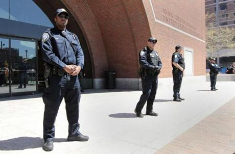 Homeland Security officers outside Moakley courthouse where three suspects are accused of helping Dzhokhar Tsarnaev.