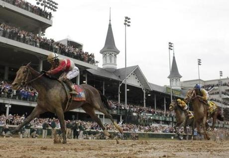 Orb (left) passed the famous twin spires and crossed the finish line first.