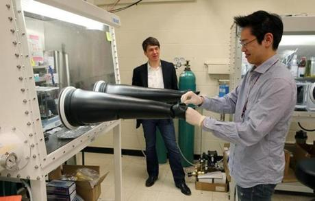 In an MIT lab, professor Gerbrand Ceder supervised as graduate student Jinhyuk Lee prepared for an experiment.