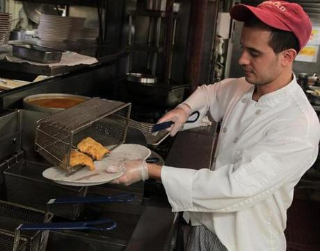 Line cook Charles Ferreira  prepared fish and chips at the Union Oyster House. Restaurant operators said they thought they were serving fresh Atlantic cod, but DNA tests showed it to be Pacific cod, a species that typically sells for $4 less a pound.