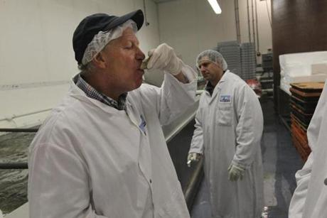 Norm Stavis, president of North Coast, sampled a fresh oyster during a tour of his fish processing business. Stavis said the company can't control how restaurants label seafood it delivers, but  added that the vast majority don't misrepresent what they sell.