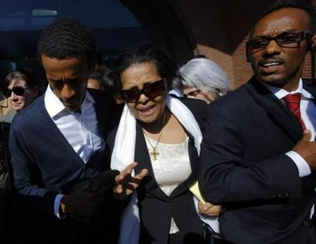 Genet Bekele, center, mother of Robel Phillipos, departed the courthouse with defense attorney Derege Demissie, right, in Boston.