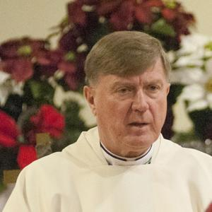 Bishop Robert McManus left the scene of a crash.