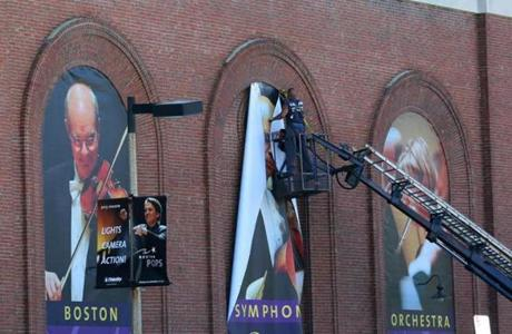 Workers tore down the old signs at Symphony hall.
