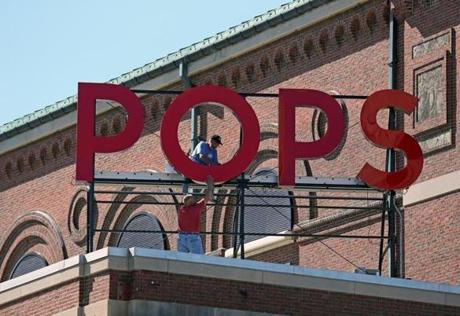 BOSTON , MA. 05/ 07/13: Boston POPS are ready for the season, new sign worked on by Dan Theroux ( cq) and up on the letters with Scott Angus ( cq) below. ( David L Ryan/Globe Staff Photo ) SECTION: LIFESTYLE TOPIC