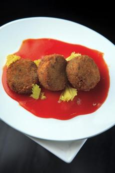 Oxtail croquettes with red-pepper mostarda.