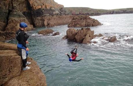 Visitors on the Wales Coast Path can try coasteering, a sport that combines cliff jumping, caving, and scrambling around rocks.