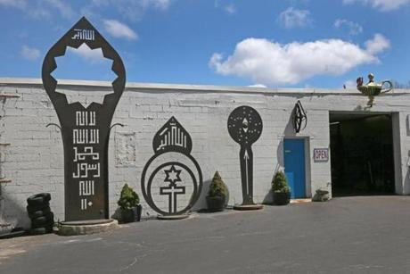 "Mahmood's steel sculptures are behind the shop. ""They're monolithic, timeless, kind of spooky,"" said Karen Boutet."