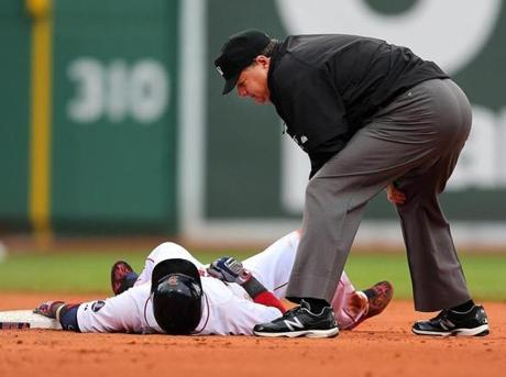 Dustin Pedroia was called out by second base umpire Jerry Layne after he tried to stretch a single into a double.