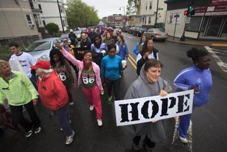 Lila Bucklin of Jamaica Plain, held her Hope sign as she participated in the 17th Annual Mother's Day Walk for Peace in Dorchester.