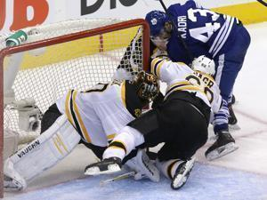 Bruins goalie Tuukka Rask had help from Jaromir Jagr on this third-period rush to the net by Toronto's Nazem Kadri.