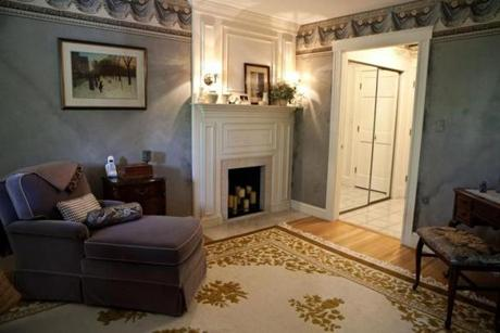 The master bedroom is one of four bedrooms and has a fireplace.