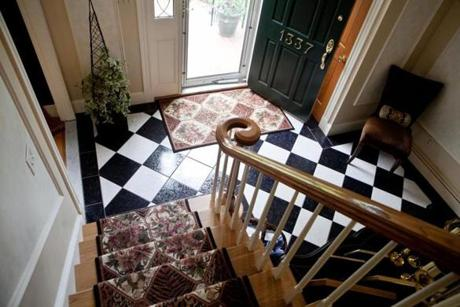 The visually dramatic floor of the entryway signals what lies ahead.