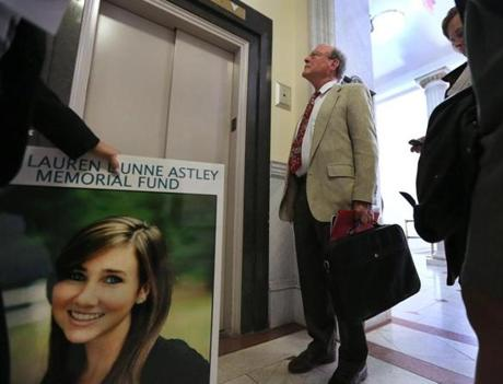 Malcolm Astley, a retired principal and school committee member, left the State House after testifying before the Legislature's education committee. He and pre-kindergarten teacher Mary Dunne want lawmakers to require dating violence prevention as part of health and sexual education programs in public schools. Their 18-year-old daughter, Lauren Dunne Astley, was murdered by her ex-boyfriend Nathaniel Fujita in 2011.