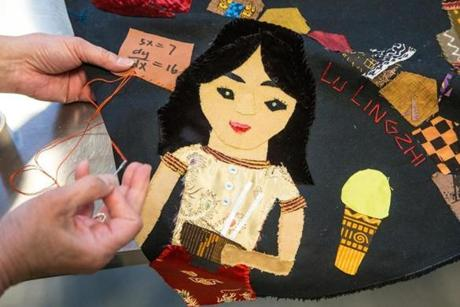 Friends of bombing victim Lu Lingzi sewed a likeness of the late Boston University student on the project.