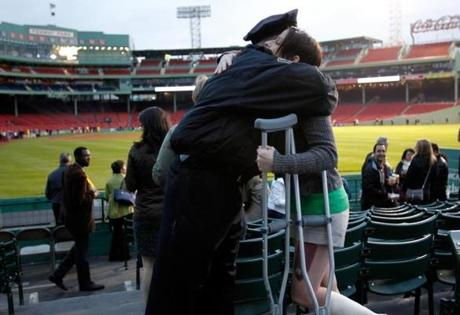 Boston Police Chief Dan Linskey gives a hug to Lee Ann Yanni, who was injured in the Marathon bombings