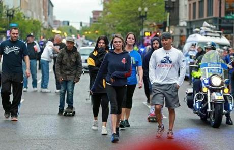 Caitlin (front) and Colleen Norden, sisters of bomb victims JP and Paul Norden, walked the Marathon route on Wednesday.