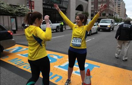 Sharon Novick and Jessica Cohen celebrated after after crossing the finish line one month after the Marathon.