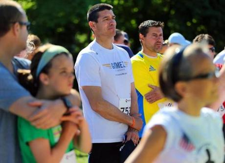 Gabriel Gomez paused with other runners during a pre-race remembrance at the Timothy Steele Memorial 5k.
