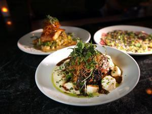 Appealing dishes on the menu include (clockwise, from front)  braised beef short rib with house gnocchi,  seared Maine salmon with roasted cauliflower ragout, and beef carpaccio.