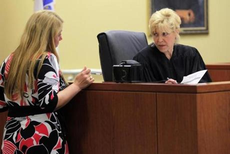 Judge Roanne Sragow spoke with probation officer Katherine Seoana during the arraignment.