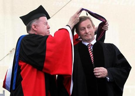 CAP AND GRIN: The Rev. William P. Leahy, Boston College president, awarded Ireland's prime minister, Enda Kenny, an honorary degree at the school's commencement in Chestnut Hill on May 20.