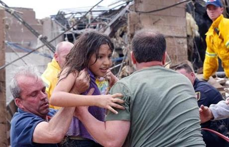 A child was pulled from the rubble of Plaza Towers Elementary School in Moore, Okla.