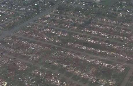 An image from television shows homes that were flattened outside Moore, Okla.