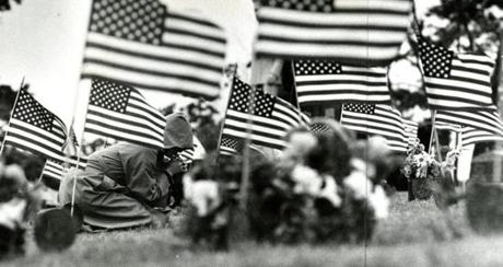 May 28, 1979:  A solitary figure crouched over a grave early on Memorial Day at the Mount Wollaston Cemetery on Sea Street in Quincy.