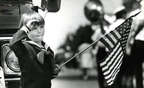 May 28 1984: Justin Billard, 5, in his sailor suit, saluted as a color guard passed his spot on Highland Avenue during the Memorial Day parade in Somerville.