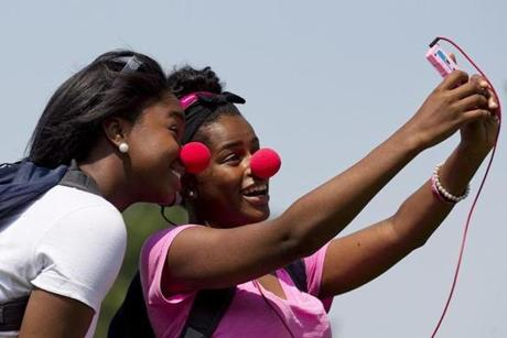 STRESS BUSTERS: Alliyah Smith and Devona Tomlinson smiled for the camera on a day devoted to stress reduction at Lexington High School on May 21.