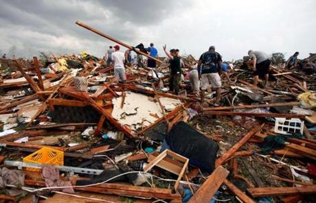 Rescuers looked for victims amid debris south of Oklahoma City.