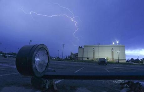 Lightning ripped across the sky in Moore, Okla., on the day after a massive tornado hit the town.