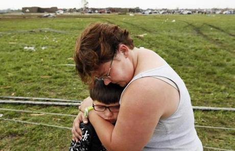 Rebekah Stuck hugged her son, Aiden, 7, after she found him in front of the destroyed Briarwood Elementary on Monday.