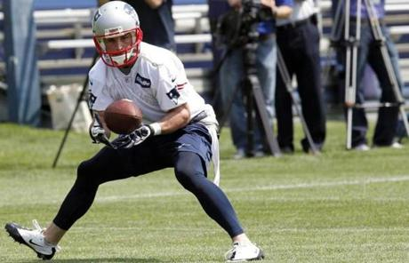 New receiver Danny Amendola, signed by the Patriots in the wake of Wes Welker's departure, worked out with Brady.