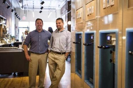 iYo co-owners Bryan Poisson and Robert Parkin opened the first froyo shop in the neighborhood.