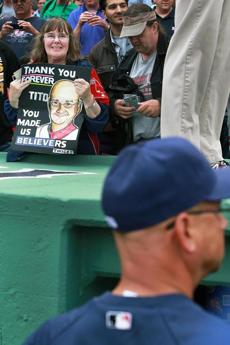 A fan held a sign honoring Francona as he signed autographs.