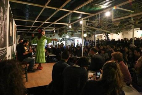 The scene at La Carboneria in Seville, Spain during a free Flamenco show.