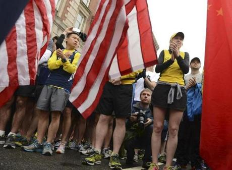 Boston, MA 052513 Three US flags and one Chinese flag were carried by volunteers in honor of the fallen during the Boston Marathon as over 1,000 runners took part in the Boston Strong One Run on Saturday May 25, 2013. The event was designed for those who couldn't finish the Boston Marathon on April 15th due to the events of that day. (Essdras M Suarez/ Globe Staff)/ MET